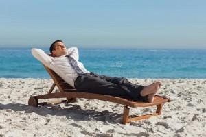 young-businessman-relaxing-deck-chair-beach-32518314